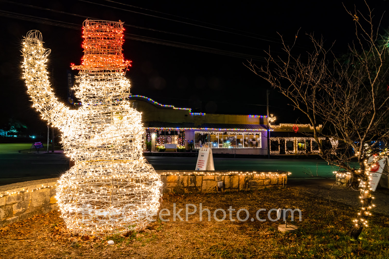 Johnson City Snowman Wave - The Snowman Waves as traffic flows through 290 through the downtown area of Johnson City Texas at...