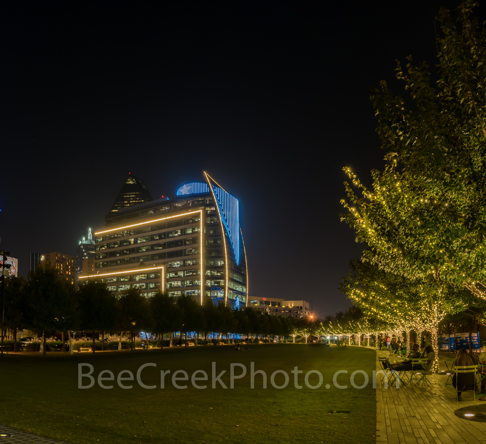 Dallas Klyde Warren Park, dark, trees, colorful Hunt Oil Building, blue lights, Dallas Cowboys, stock photos, pano, panorama,, photo