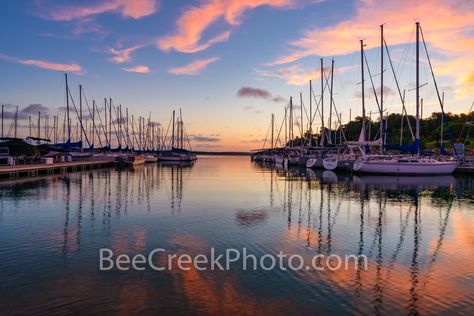 Lake Travis Sunrise - In the early morning right before the sun came up we capture the sunrise colors over this marina on Lake...