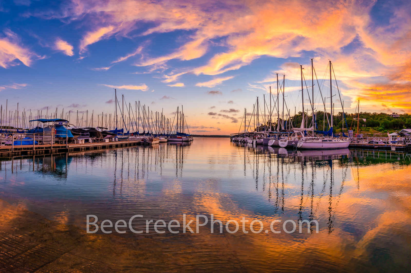 Lake Travis Sunrise Reflections Landscape - We captured this beautiful sunrise landscape over the marina on Lake Travis in the...