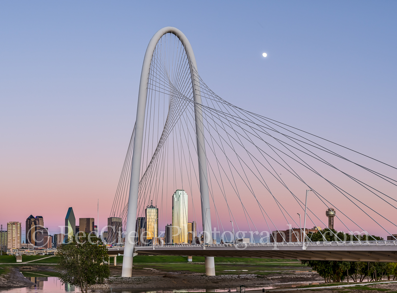 Margaret Hunt Hill Bridge Pano-Dallas skyline at twilight through the Margaret Hunt Hill Bridge with a stunning colorful...