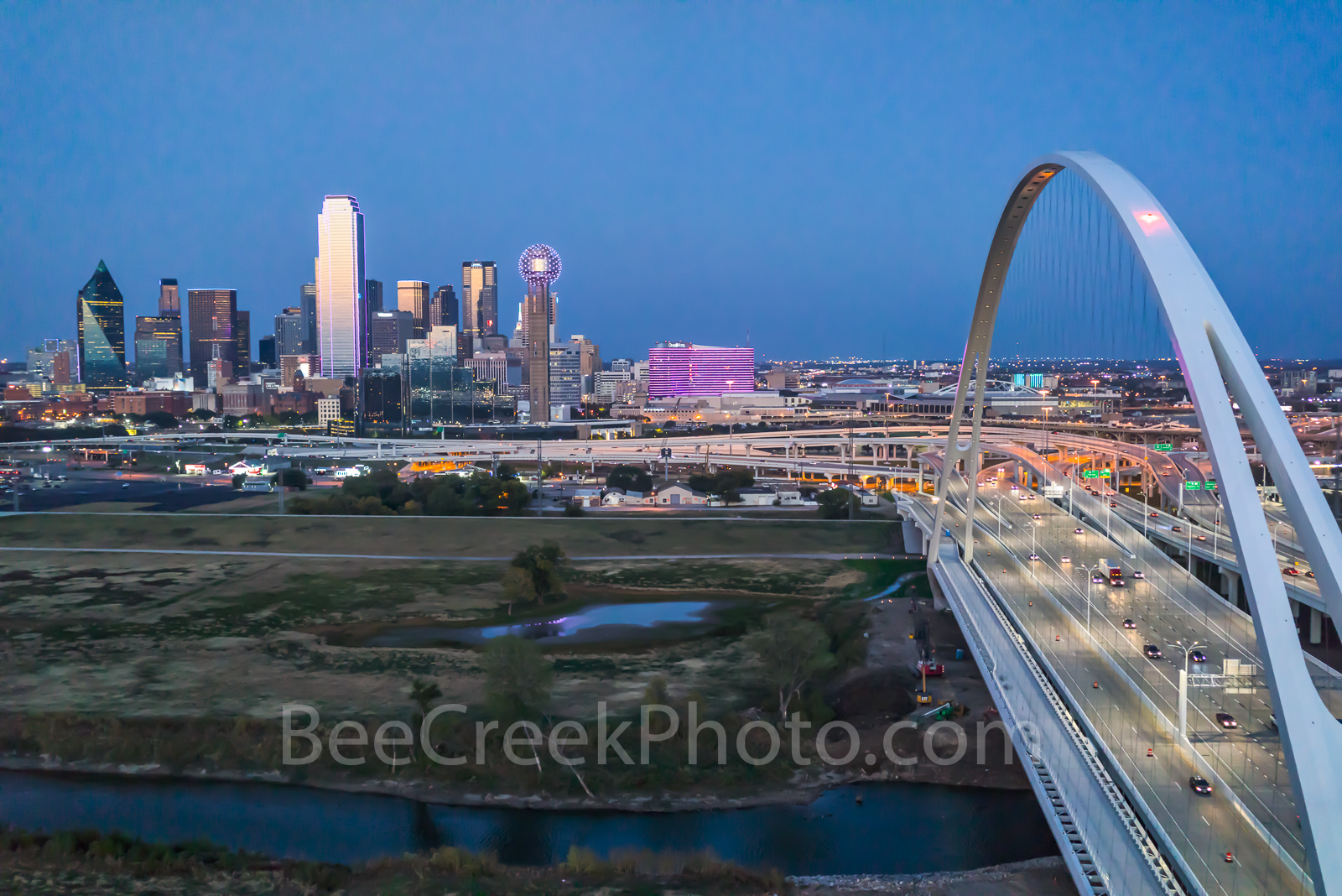Dallas skyline with the Margaret McDermott bridge at the blue hour in downtown. In this view you can see the Reunion Tower, the...