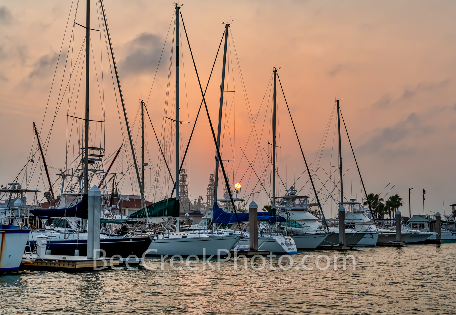 Marina Sunset Port Aransas -  Sail boats at the marina as the sunsets with this orange pink glow in Port A.  The sailboats were...