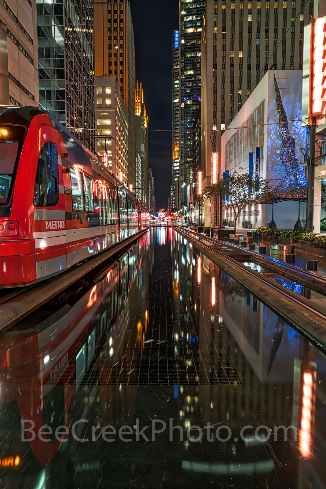 Houston, rail, mass transit, dark, night, purple lights, city, skyline, downtown, cityscape, cityscapes, street scene, high rise, buildings, water, Houston stock, , photo