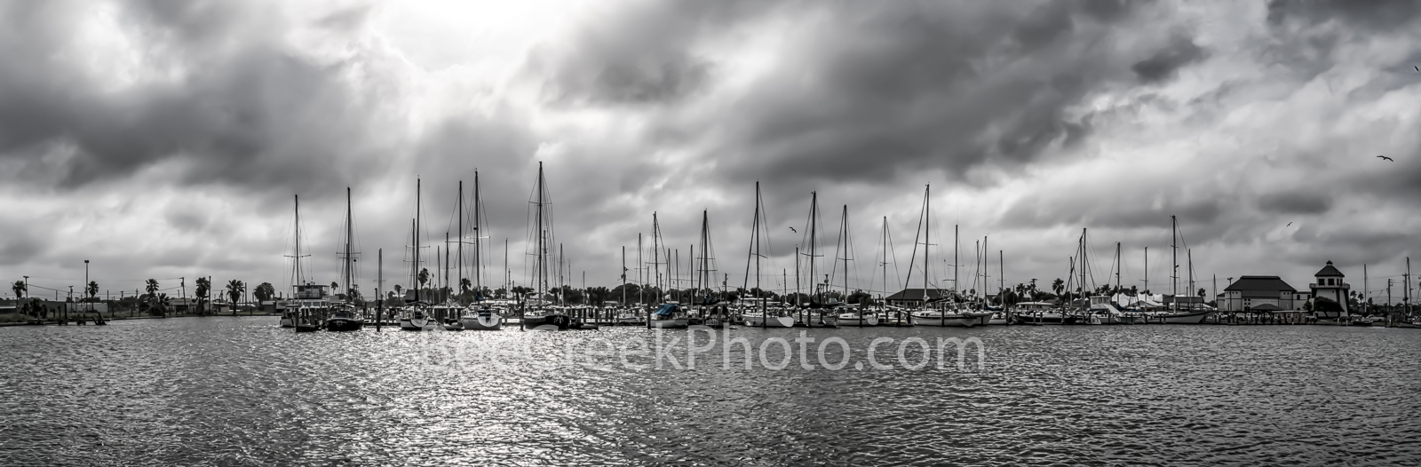 Moody Skies Over Marina B W Panorama - The marina in Rockport Texas with moody cloudy skies in black and white panorama. We capture...