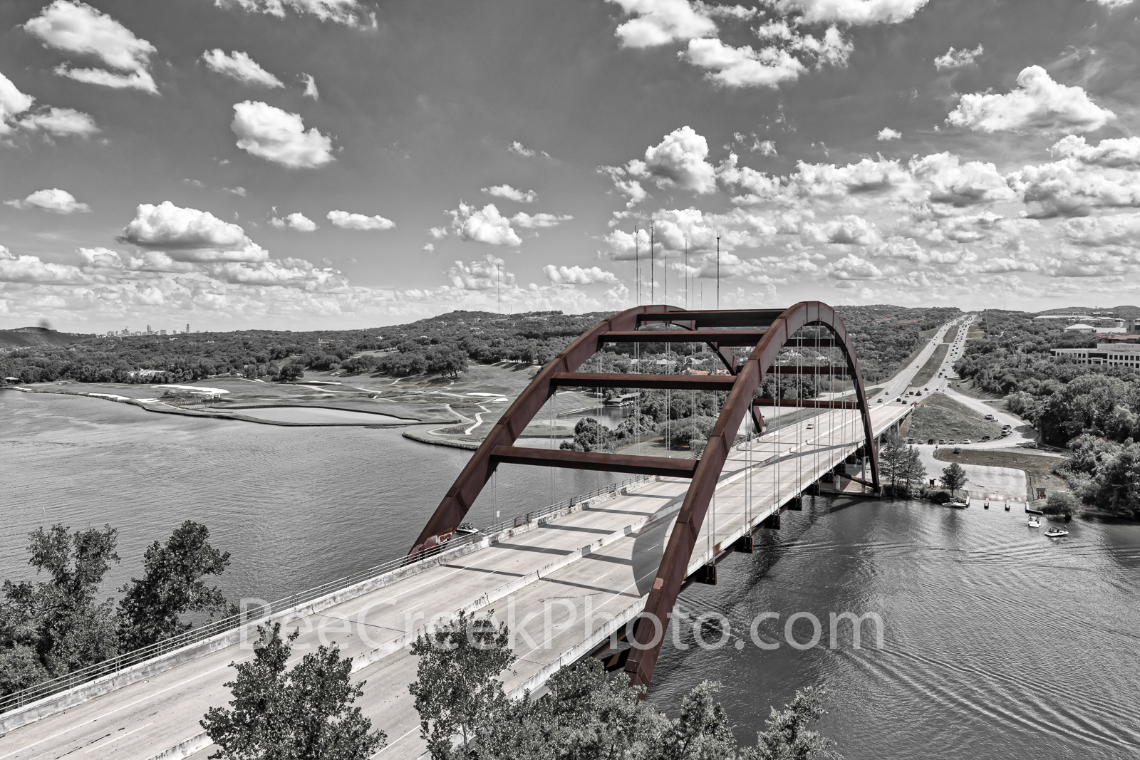 Pennybacker Bridge BW with Pop of Red 2 -  Austin Pennybacker Bridge or Austin 360 bridge with a beautiful cloudy sky and a little...