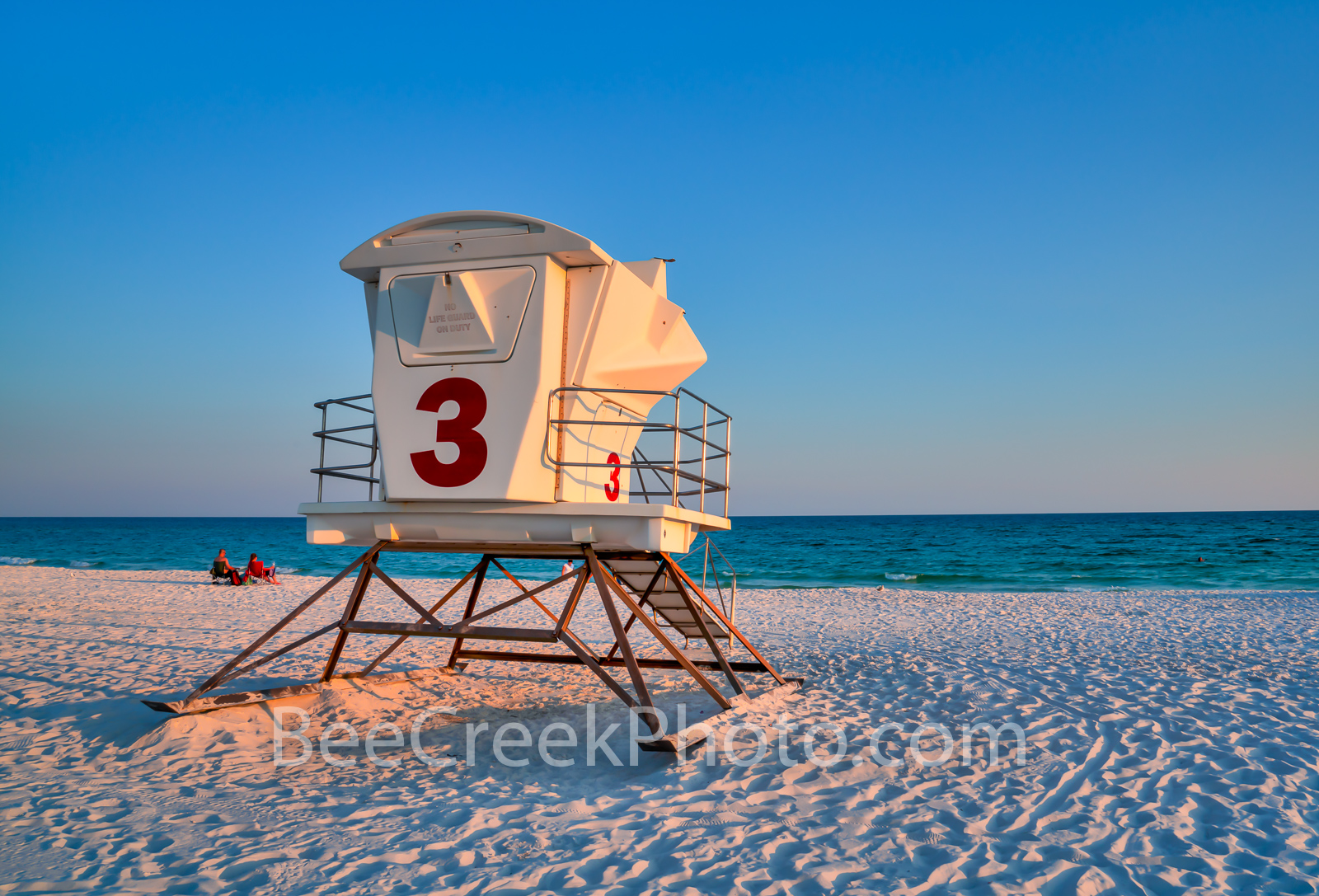 Pensacola Beach Lifeguard Station - Pensacola beach right before the sunset over the gulf with lifeguard station on the beach...