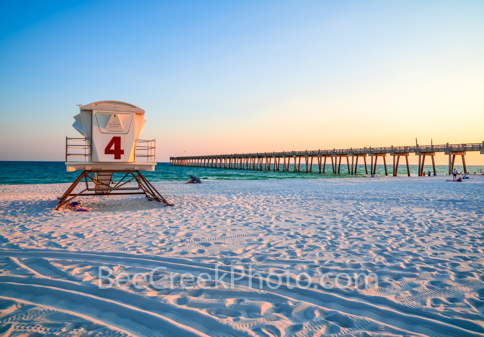 Pensacola Beach Pier and Lifeguard Station -  Pensacola beach and pier right before the sunset over the gulf with lifeguard station...