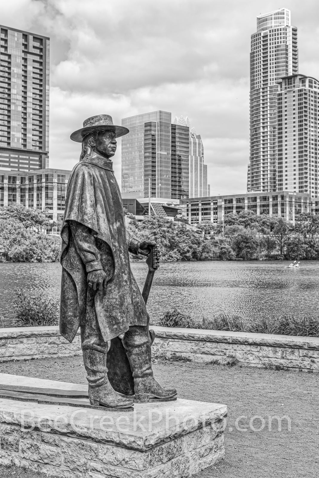 austin, stevie vaughan statue, bw, black and white, bronze, independent, jingle, high rise, skyscraper, lady bird lake, butler hike and bike trail, blues, guitar, , photo