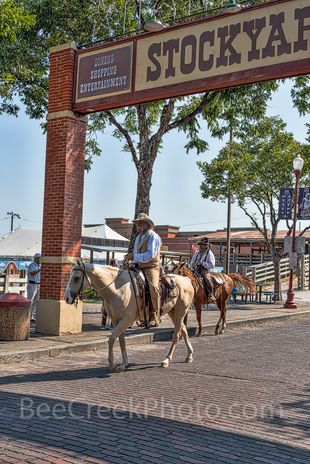 Stockyard and Cowboys - A couple of cowboys riding their horses at the Stockyard in Fort Worth Texas. They were just...