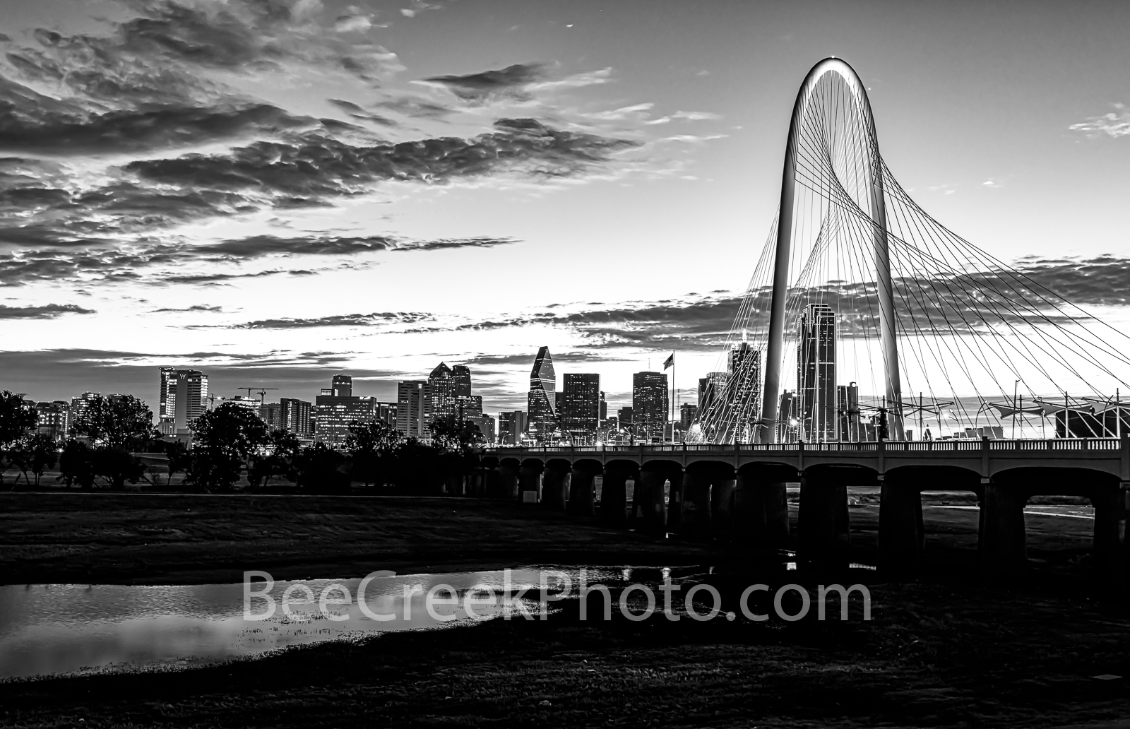 Sunrise at Margaret Hunt Hill Bridge B W - Sunrise at the landmark Margaret Hunt Hill Bridge with Dallas skyline early morning...