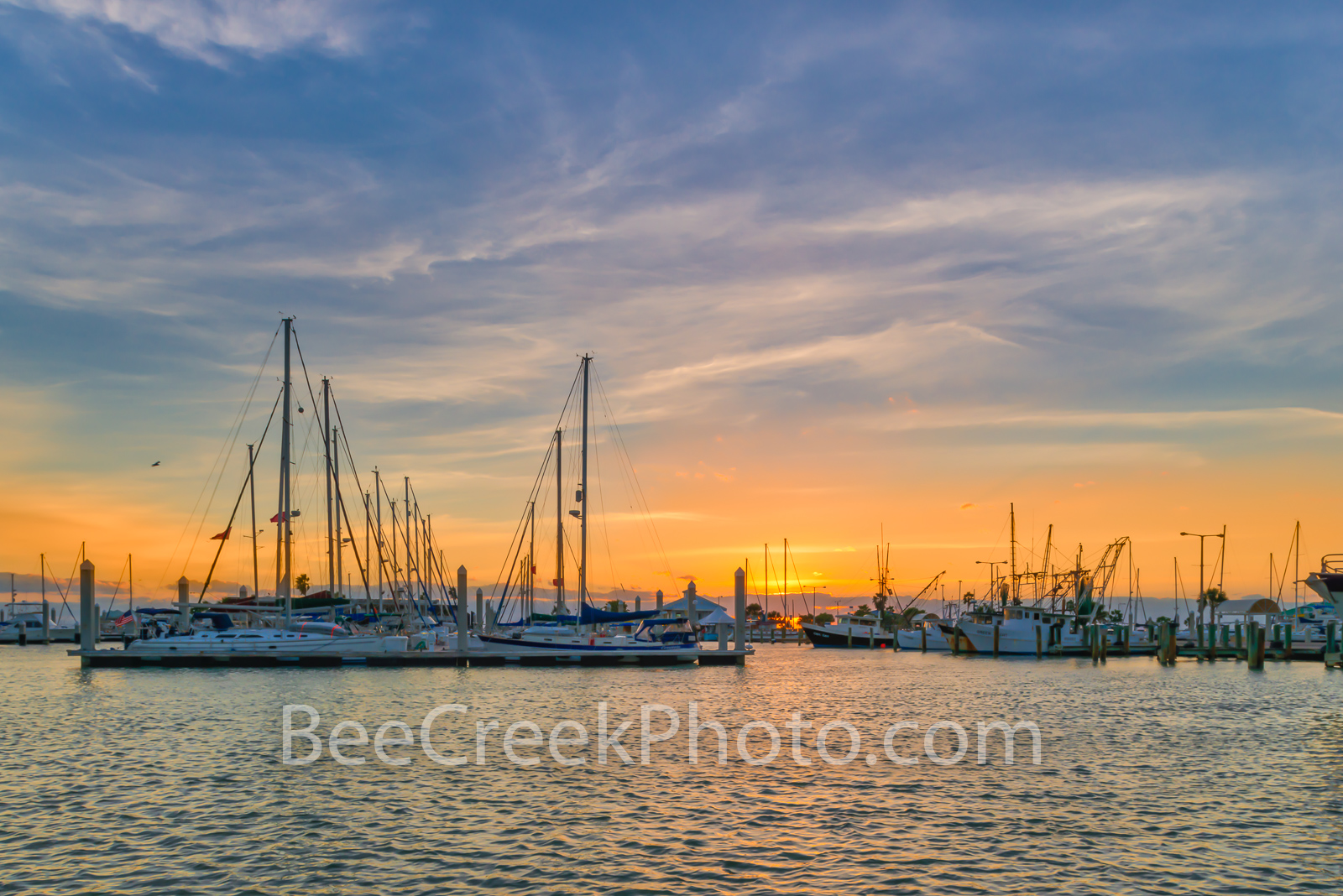 Sunrise Over the Marina - We took this photo of the sunrise over the marina in Corpus Christi Texas. The sunrise was just peaking...