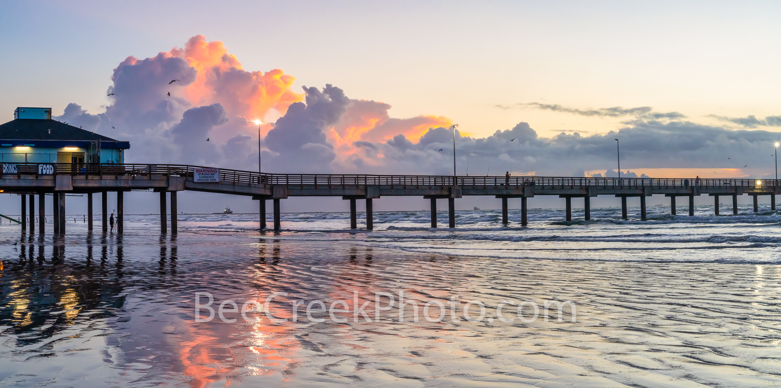 Sunrise Over the Pier Port Aransas TX Pano - The clouds start to light up with color at the Port Aransas Pier shortly before...