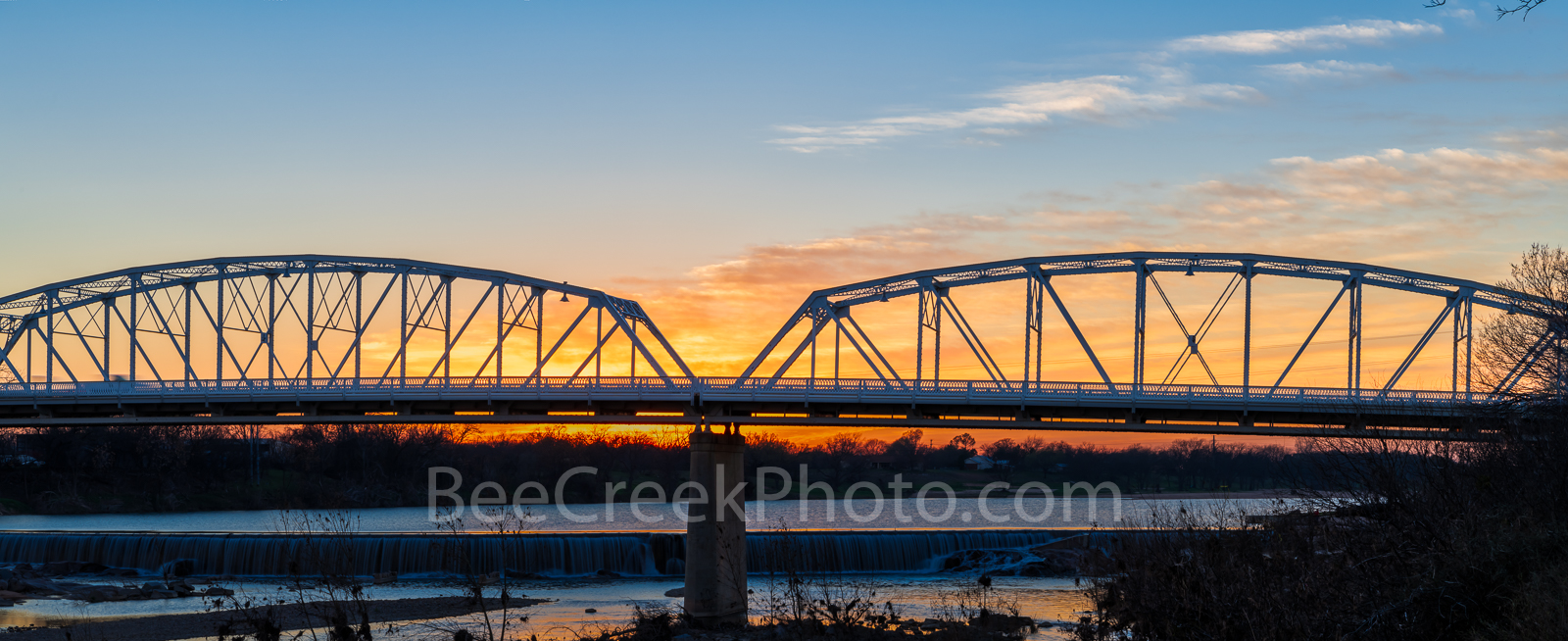 Sunset at Llano Bridge Pano - The Llano bridge pano in the Texas Hill Country as the sunset in the west. The Llano river runs...