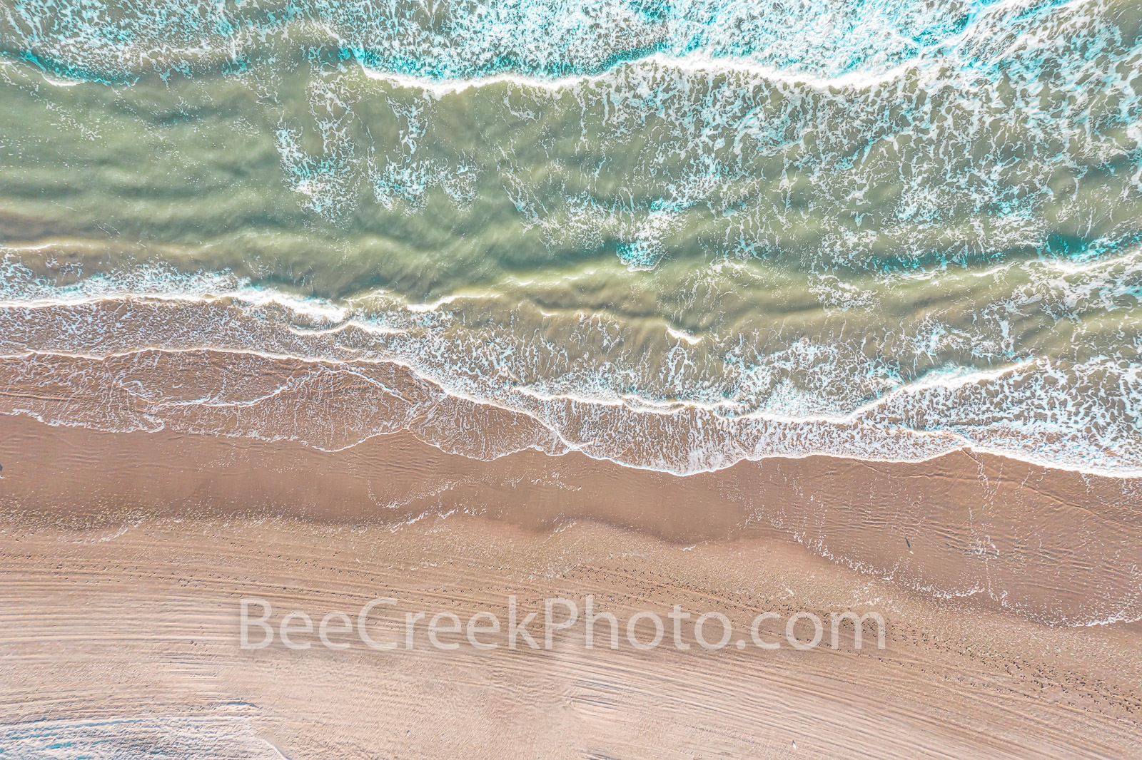 Sand Surf Abstract 2 - This aerial view of the surf and sand along the Texas coast taken from a birds eye view with our aerial...