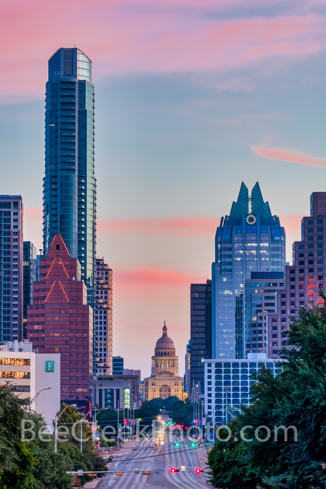 Texas Capitol Sunrise from Austin SOCO Vertical - A view looking up Congress toward the Texas Capitol in downtown Austin skyline...