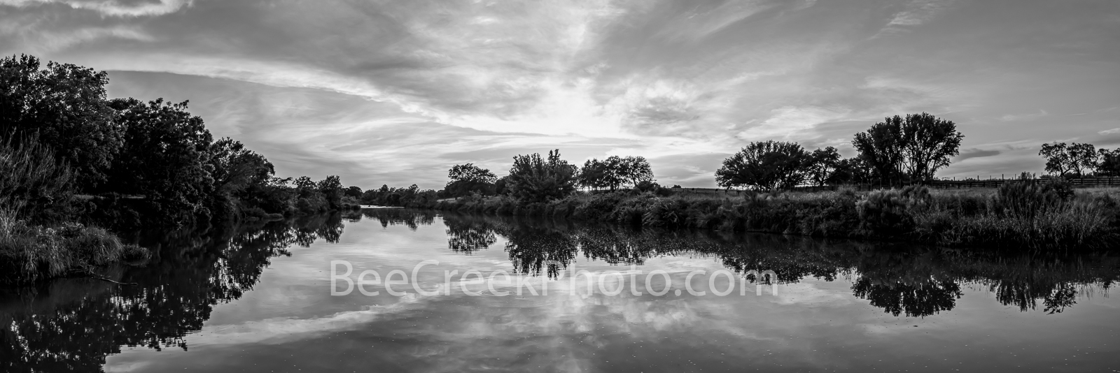 Texas Hill Country Sunset Panorama BW - Texas hill country sunset panorama in black and white along the Texas river. The sun...