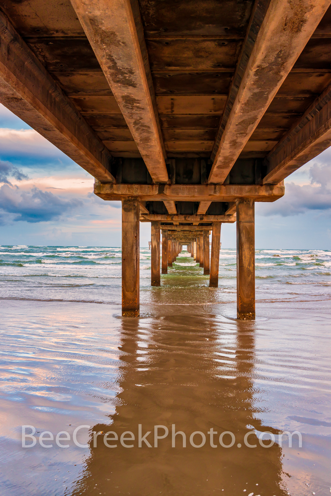 Texas Pier Vertical 2 - Took this shot as a tropical storm was approaching along the texas coast in Port Aransas and was creating...