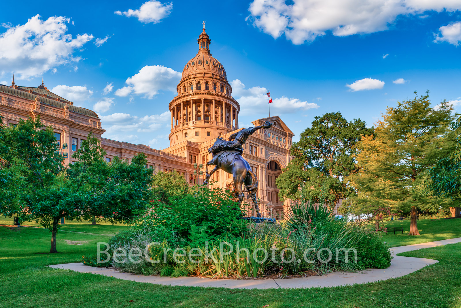Texas State Capitol with Cowboy Statue - This is the Texas Cowboy Monument in front of the State Capital in Austin Texas.  The...