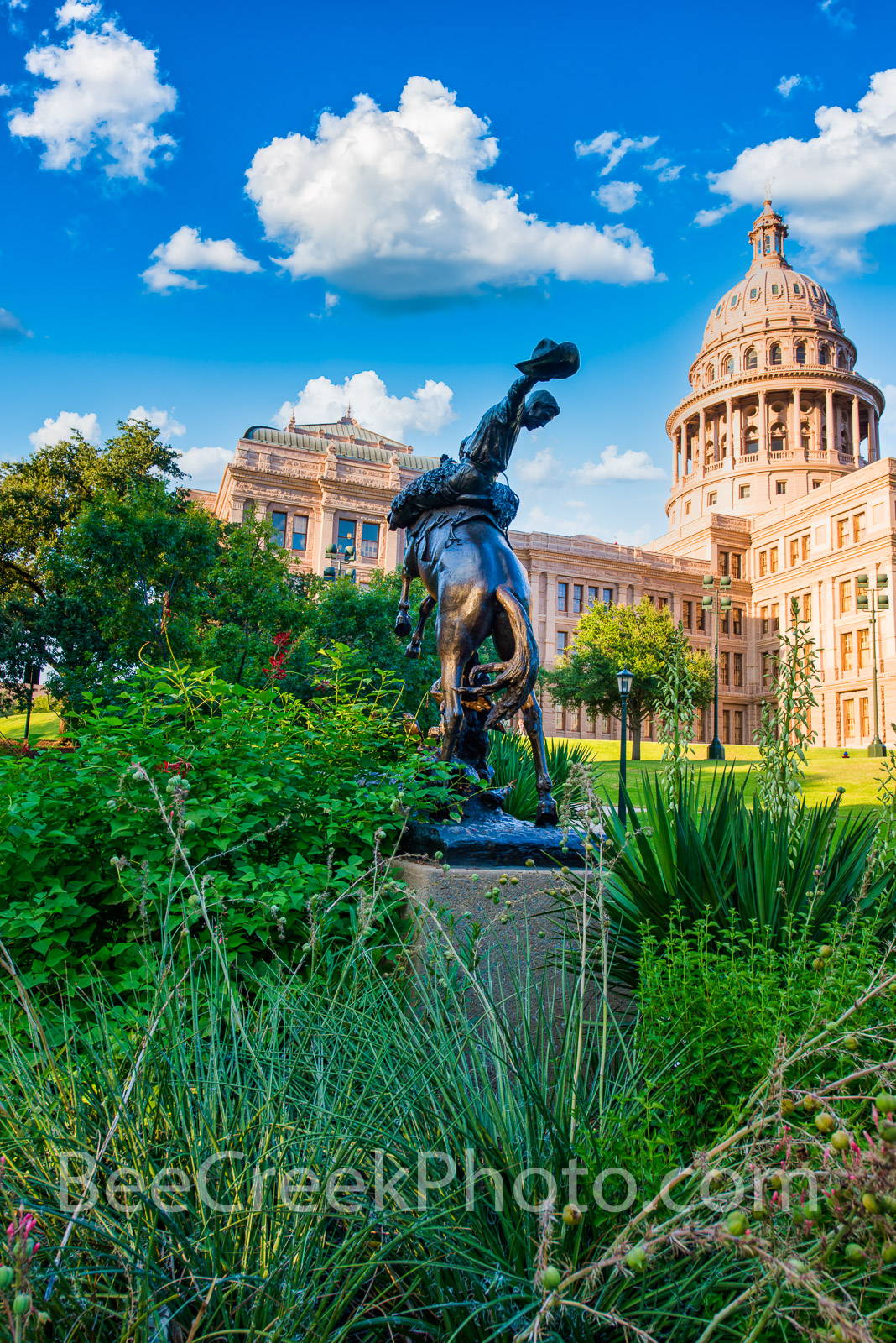 Texas State Capitol with Cowboy Statue Vertical - This is the Texas Cowboy Monument in front of the State Capital in Austin Texas...