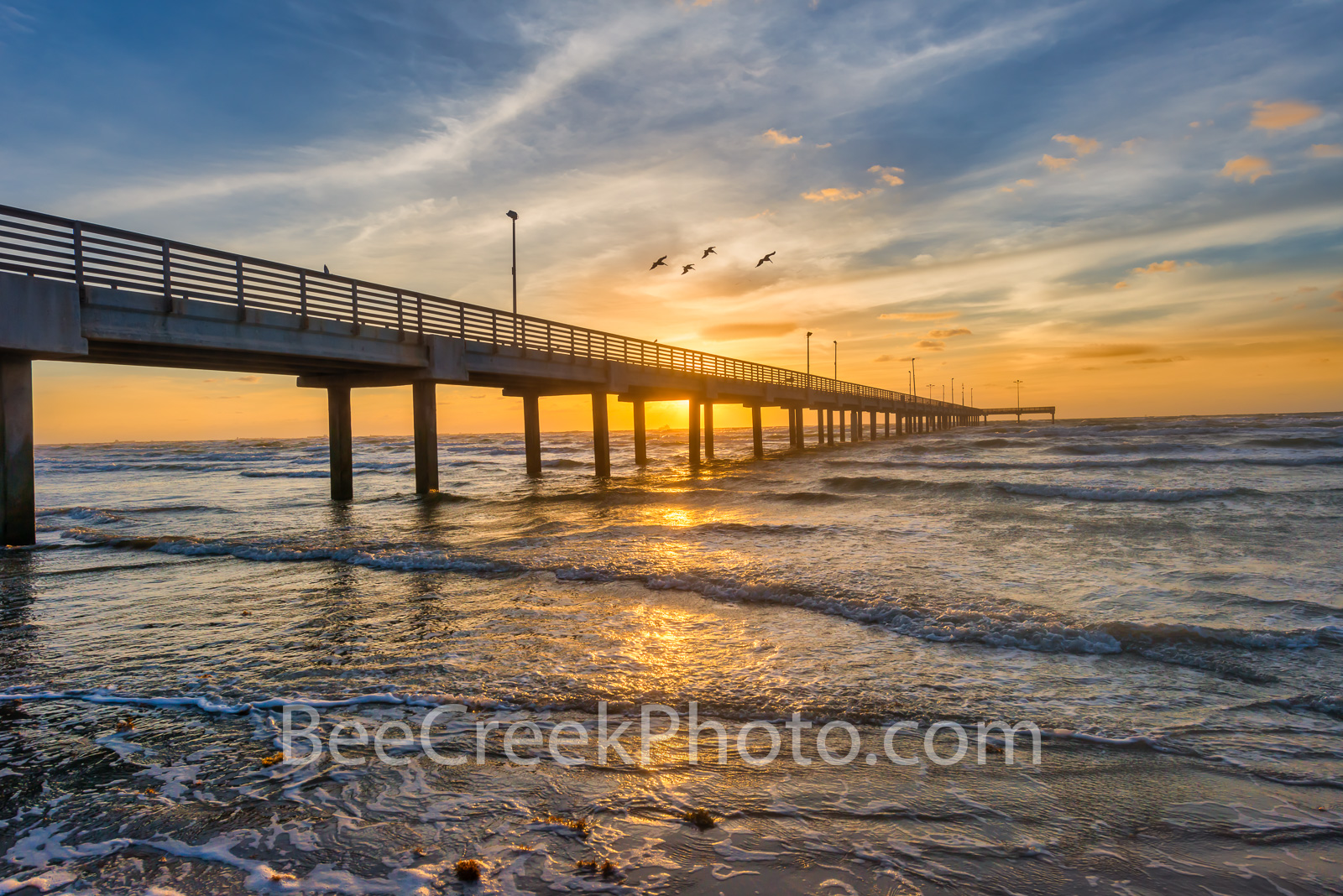 Texas Sunrise Glow Over the Pier - Texas Sunrise glow at the coast early morning at the Caldwell fishing pier we capture this...
