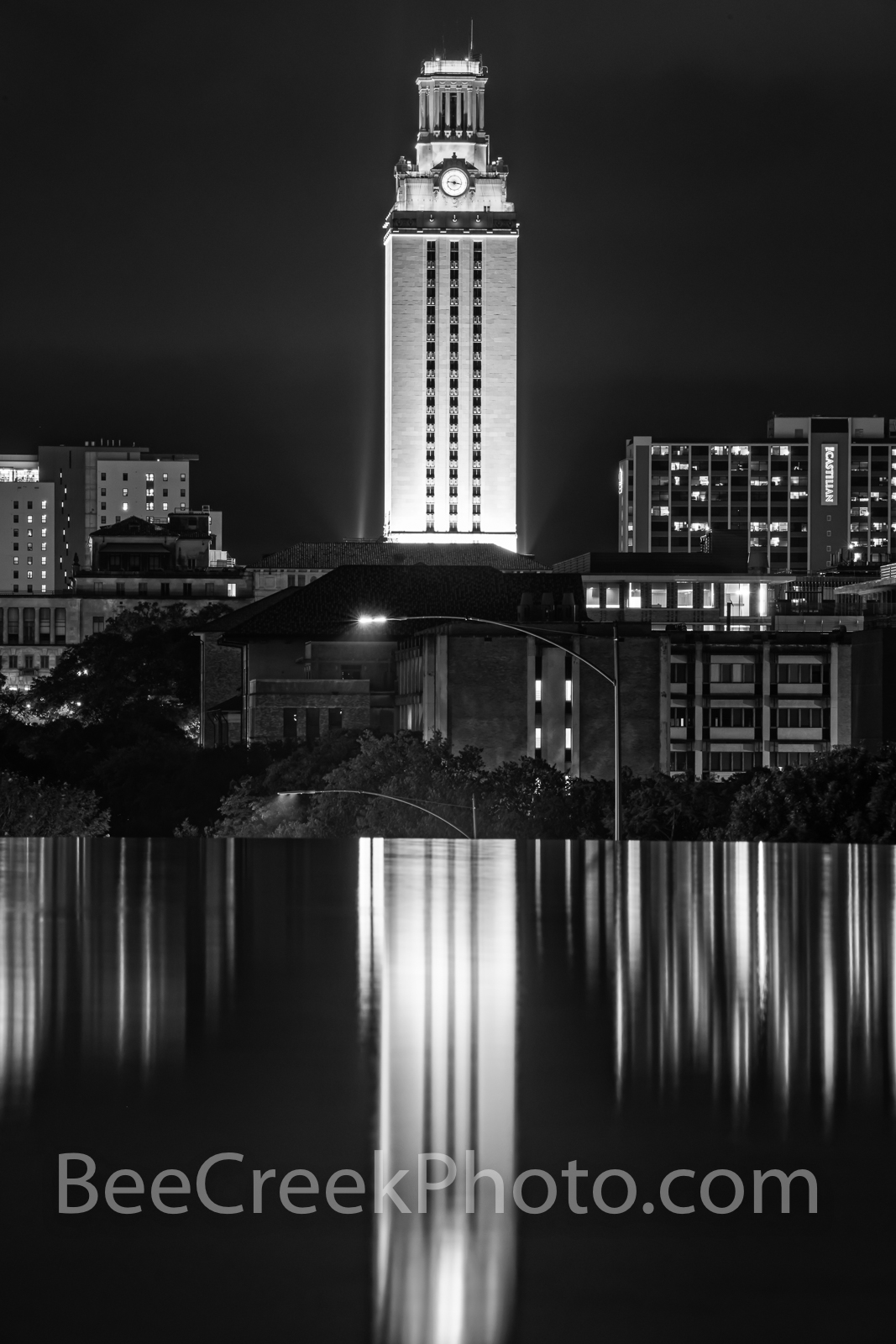 UT Tower Reflection Vertical B W - This is U T Tower lit up at night as it reflects in the water feature near campus in black...