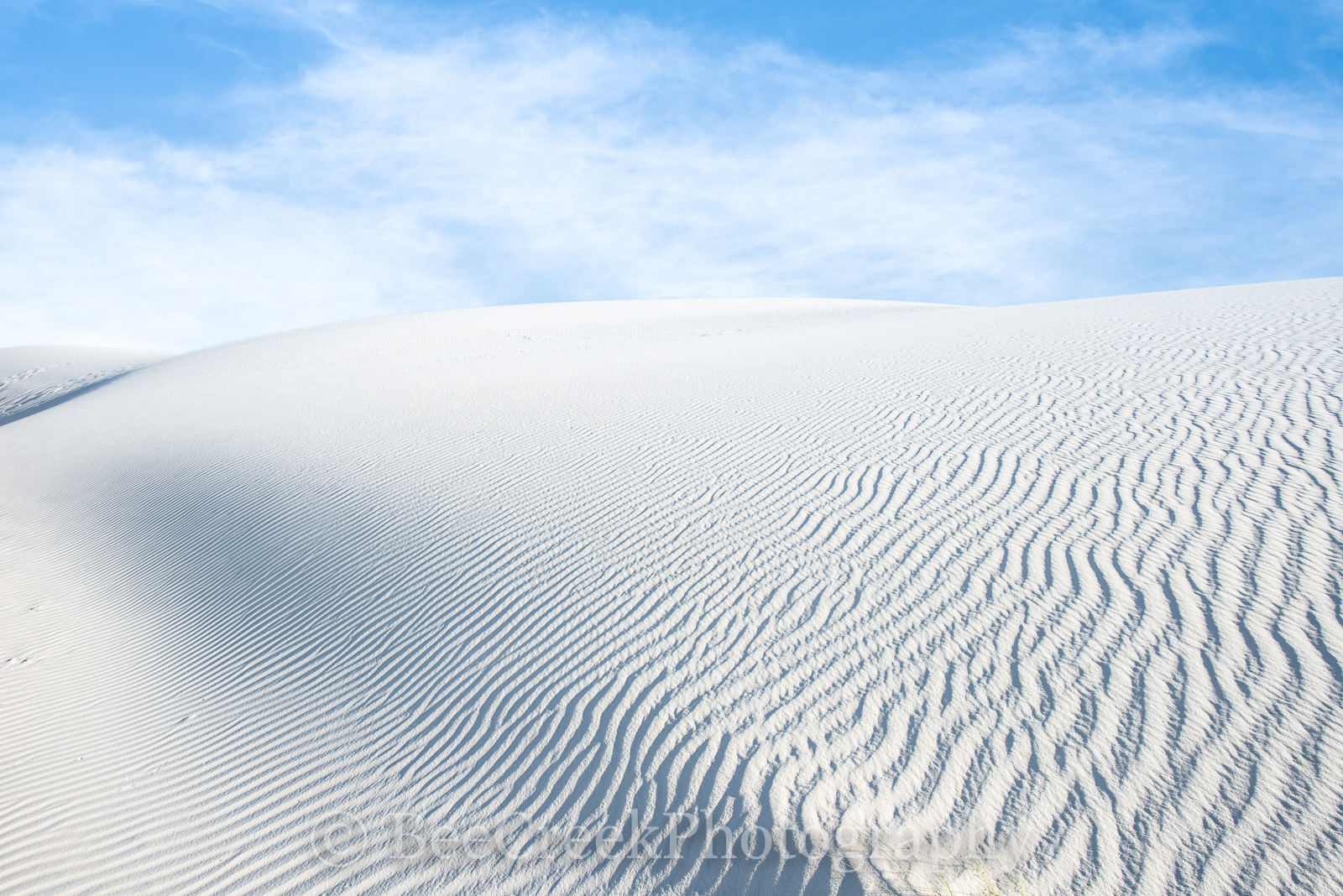 White Sands of NM- Sand dunes in White Sands New Mexico. These dunes are endless desertlandscape of white with...